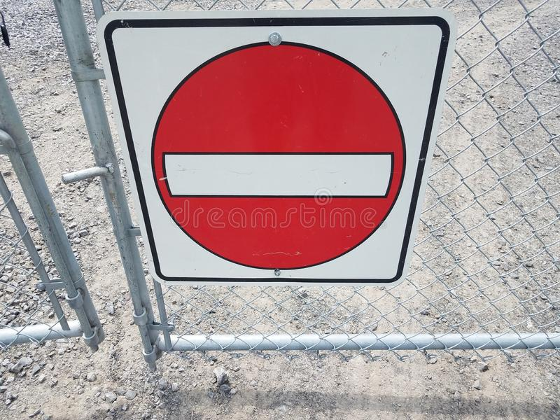 Red and white do not enter sign on metal fence. Or gate stock photo
