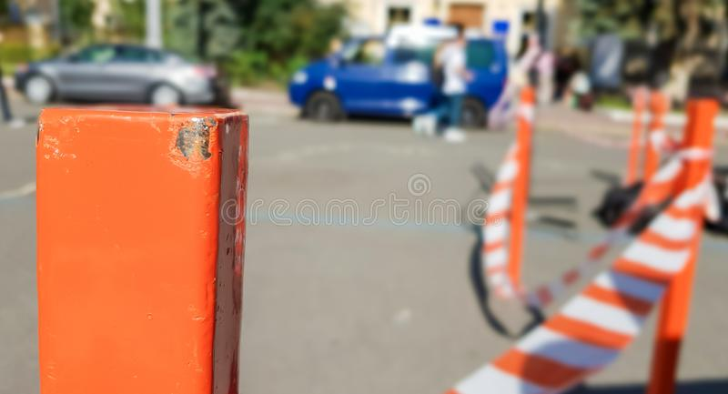 Red white does not cross the tape and the metal pole. Signal red and white tape hanging on a metal fence, danger, warning. Ribbon. And metal red post. Forbidden stock images