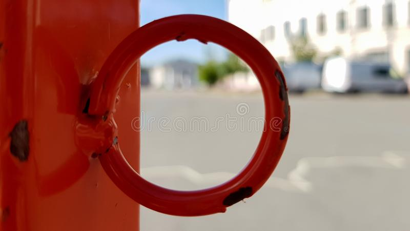 Red white does not cross the tape and the metal pole. Signal red and white tape hanging on a metal fence, danger, warning. Ribbon. And metal red post. Forbidden royalty free stock images