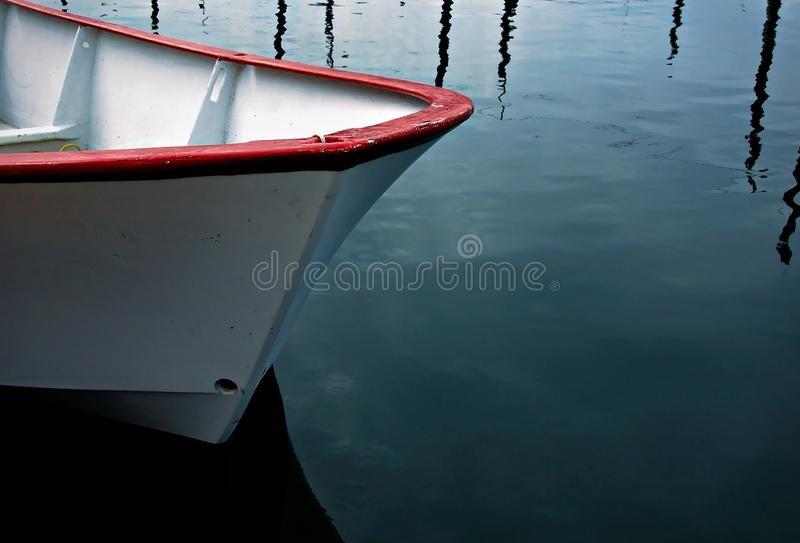 Red and white dory floating on calm waters. Red and white dory floating on calm waters in Seldovia, Alaska stock images