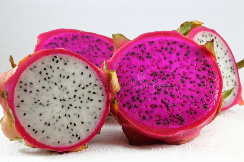 Red and white dragon fruit royalty free stock photos