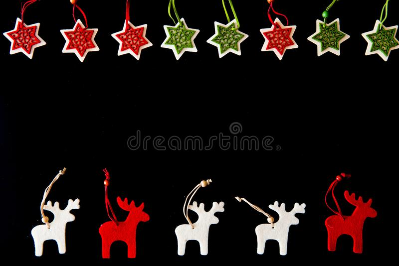 Red and white felt reindeers and snowflakes stock photography