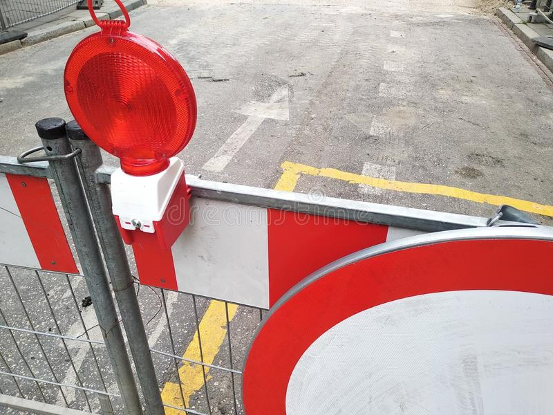 Red and white fencing during road repairs, construction or unforeseen situations. red light to warn of danger. the rules of the. Red and white fencing during stock photo