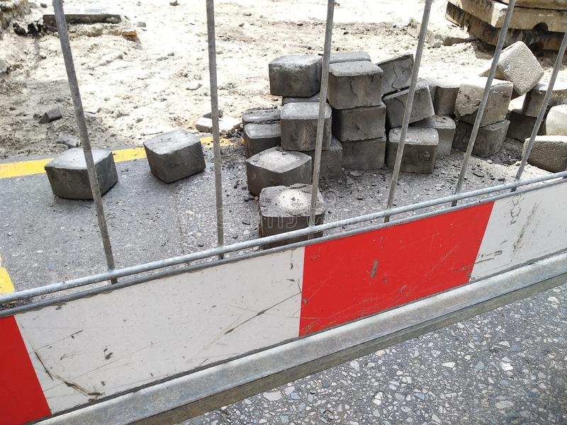 Red and white fencing during road repairs, construction or unforeseen situations. red light to warn of danger. the rules of the. Red and white fencing during stock photos