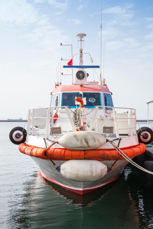 Red and white fire boat stands moored in Izmir stock photography