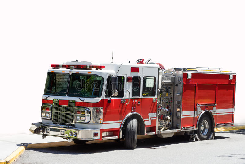 Red and white fire truck. Isolated red and white fire truck on standby waiting for an emergency stock image