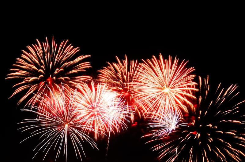 Red and white fireworks display on dark sky background.  stock photo