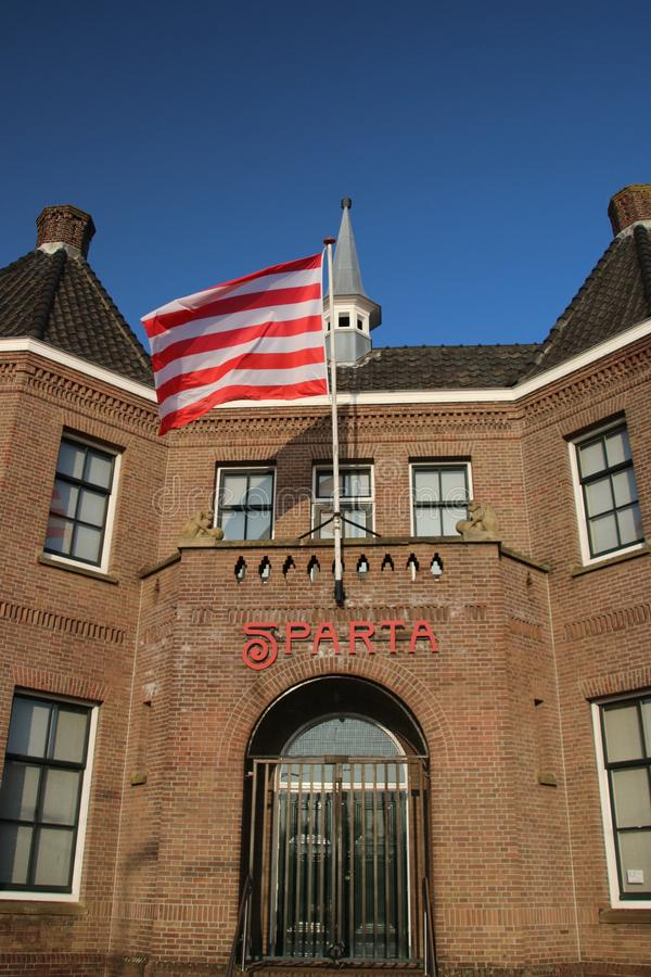 Red white flag on the front of the footbal stadium of Sparta in Rotterdam named Kasteel Castle in English stock photo