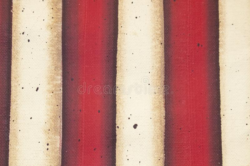 Red and white flag striped background of painted canvas with grunge effect royalty free stock photos