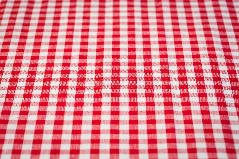 Gingham. Red and white gingham tablecloth background royalty free stock image