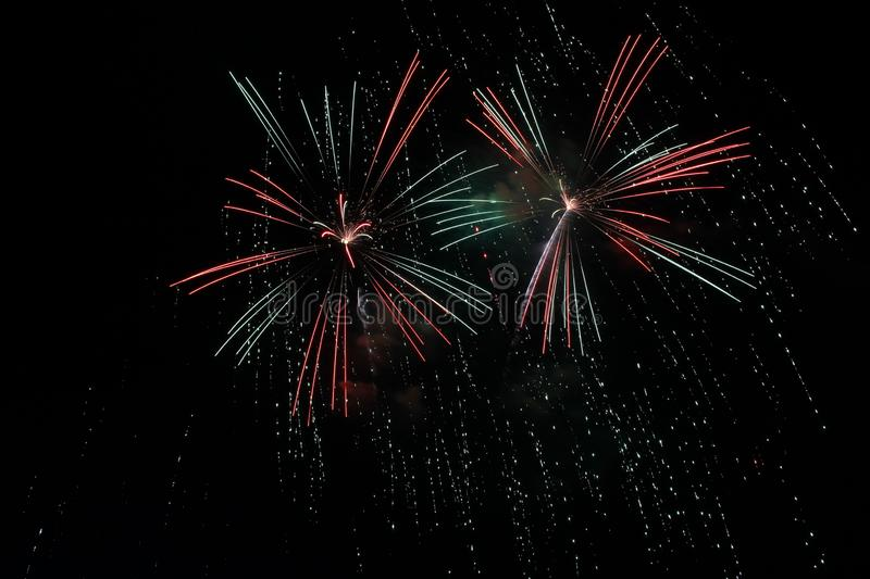 Red, White, Green and Blue Fireworks royalty free stock images