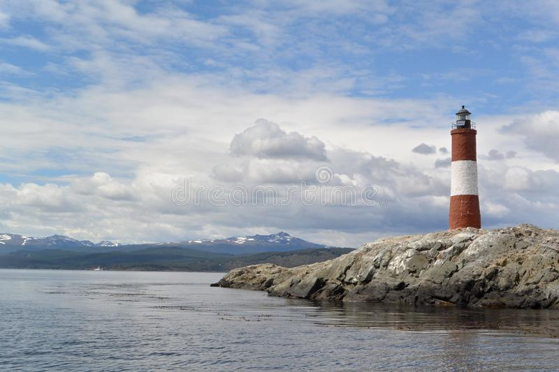 Red and white lighthouse on a beautiful sunny day stock photos