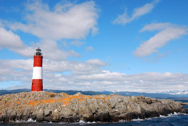 Red and white lighthouse. In blue sky in the Beagle Channel Ushuaia Patagonia Argentina royalty free stock images
