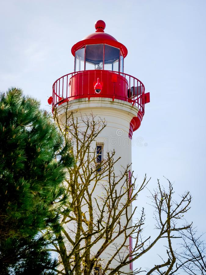 Red and White Lighthouse at La Rochelle, France. LA ROCHELLE, FRANCE - MARCH 29, 2017: Red and White Lighthouse near Charente Maritime at La Rochelle, the French stock photography