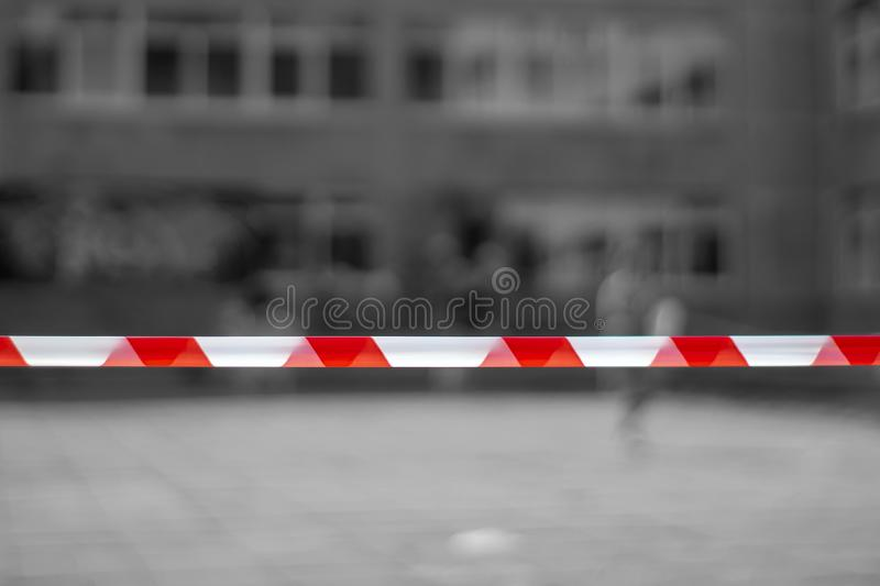 Red and white lines of barrier tape. At the metro station, the airport background. crime scene stock image