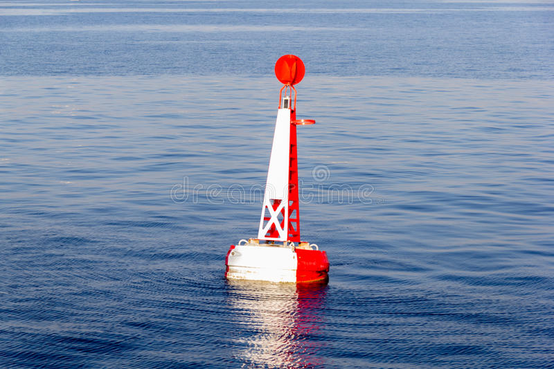 Red white moored buoy. In blue sea royalty free stock images