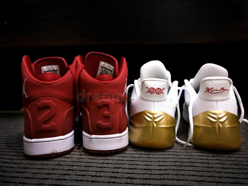 Red and white Nike Michael Jordan 23 sneakers - Kobe Bryant nike sneakers Black Mamba royalty free stock images