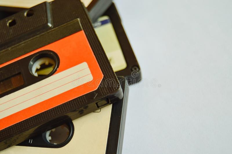 Red and white old audio cassette background with copy space. 80s-90s. Close-up stock photography
