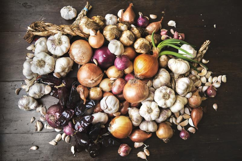 Red White Onions and Garlic On Rustic Wood royalty free stock images