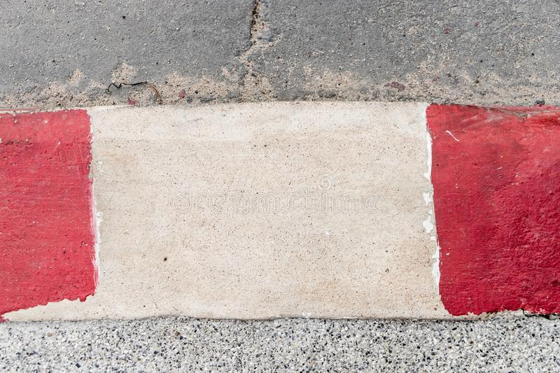 Red and White paint on street for no parking. Red and White paint on street pavement for no parking royalty free stock photo