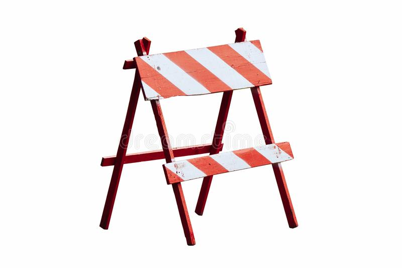 Red and white painted vintage wooden road block or barrier as wood frame barricade with four legs isolated on white background royalty free stock photo