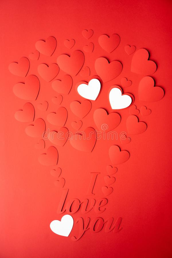 Red and white paper background, cut out hearts are lined up in the shape of a balloon. Words I love you. Set of 4 photos. stock photo