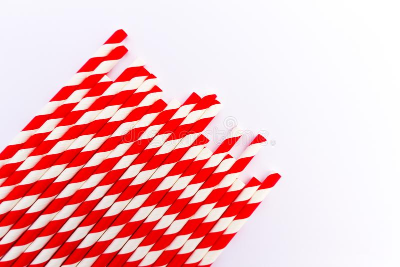Red and white paper straws. Red and white striped paper straws on a white background stock images