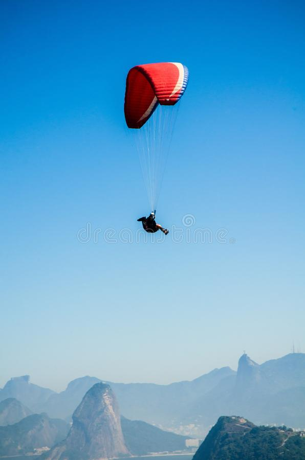 Red White Parachute on Top of Mountains during Daytime royalty free stock image