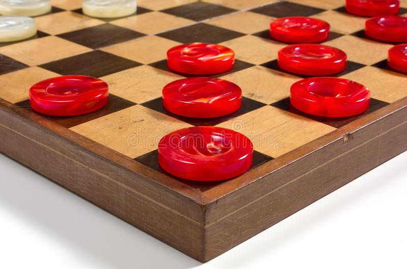 Red and White Pieces on a Checkerboard. Red and white pearly pieces in the starting position on a checkerboard stock photography