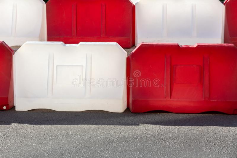 Red and white plastic road blocks close up stock photos
