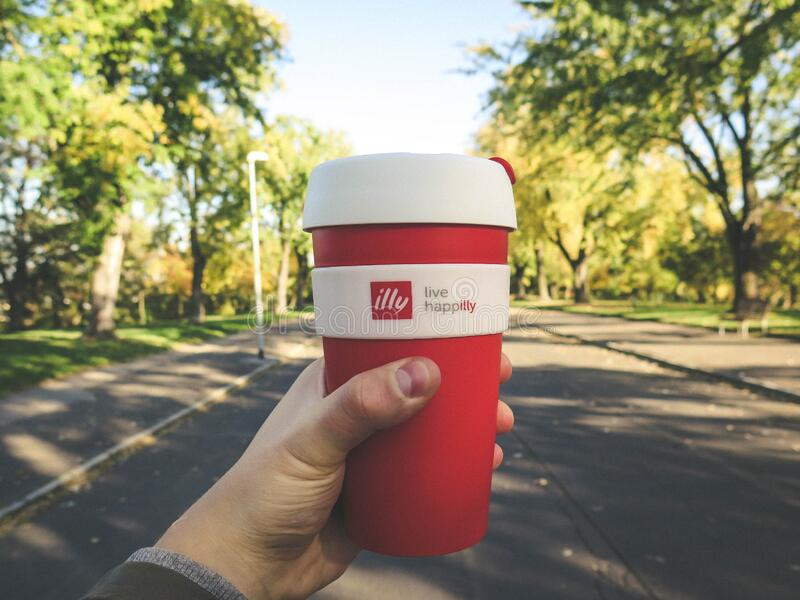 Red and White Plastic Tumbler stock photography