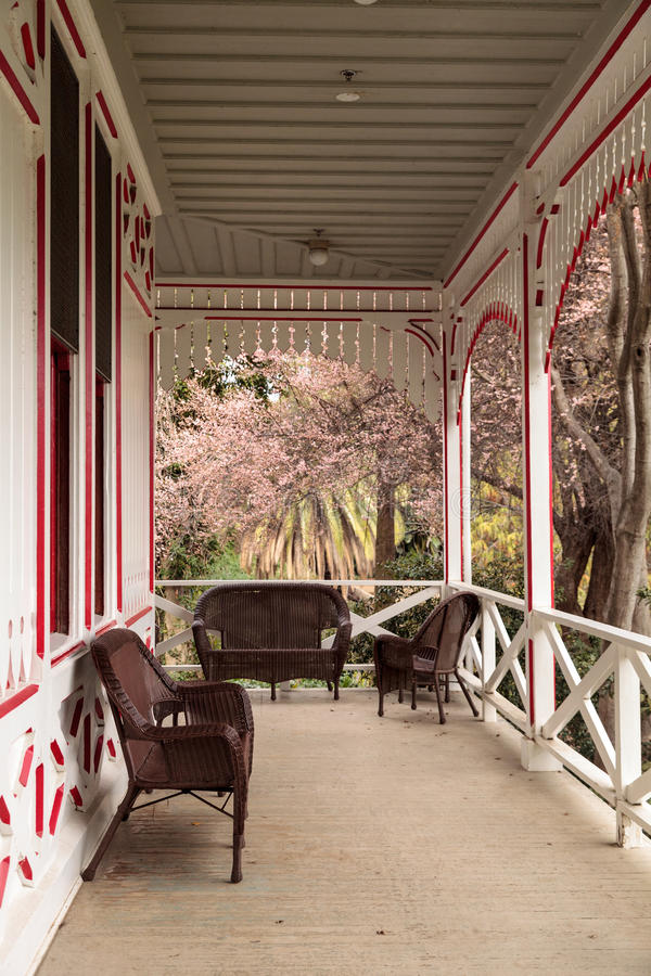 Red and white porch of a Victoria cottage stock image