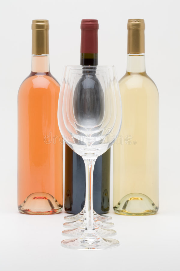 Red White And Rose Wine Bottles With Glasses Royalty Free Stock Images