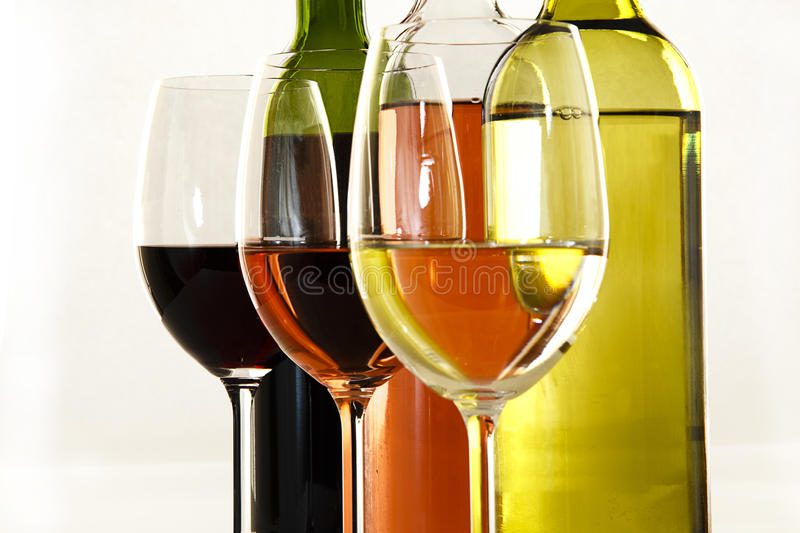 Red, white & Rose wine with glasses royalty free stock images