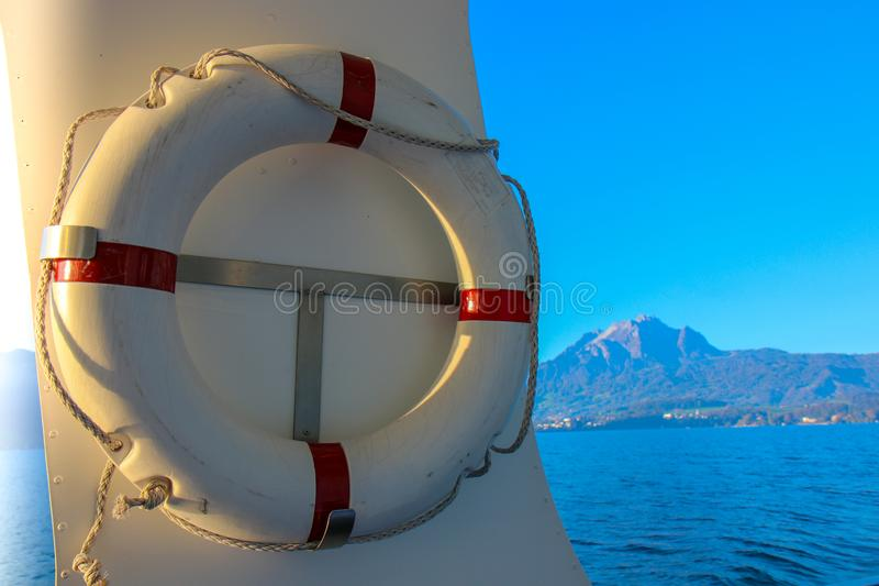Red and white safety torus or lifebuoy hanging royalty free stock photo