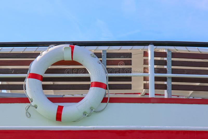 Red and white safety torus or lifebuoy hanging. On the boat stock photography