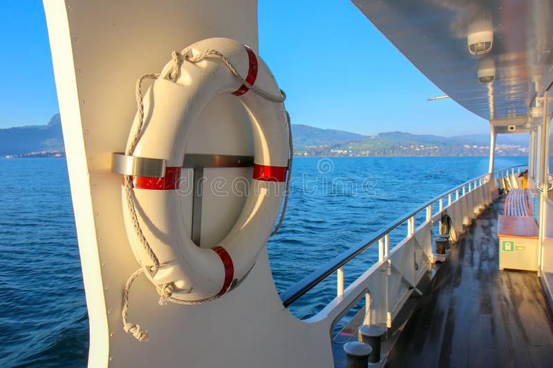 Red and white safety torus or lifebuoy hanging. On the boat stock photo