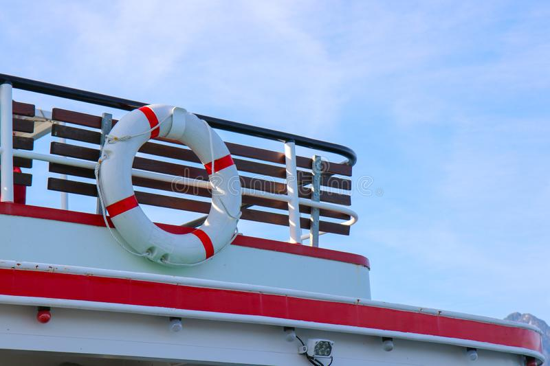 Red and white safety torus or lifebuoy hanging. On the boat royalty free stock photos