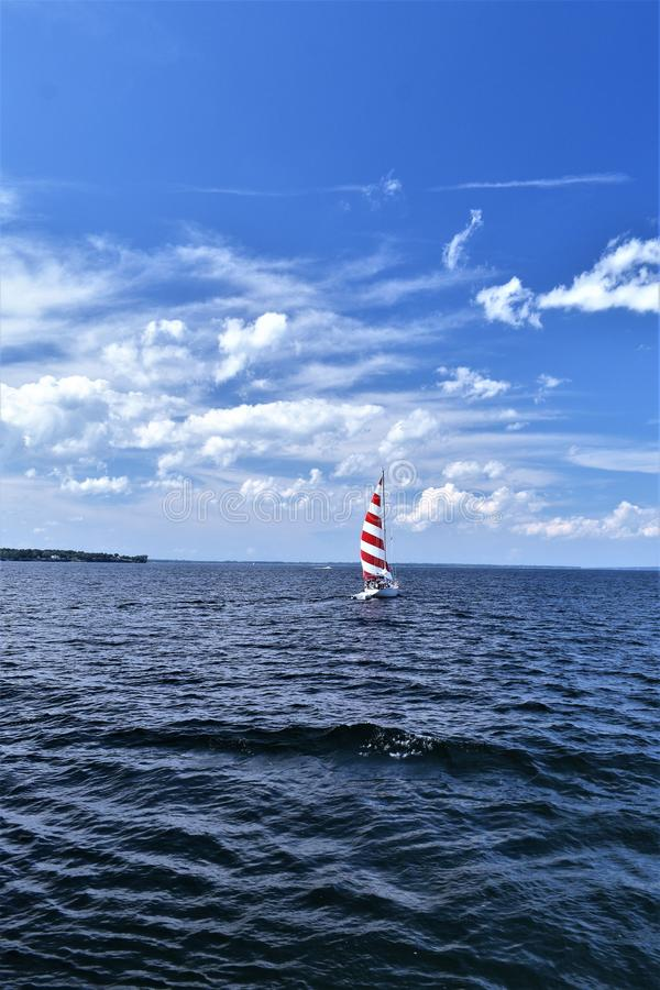 Red and White Sail Boat on Lake Champlain, New York, United States, US. USA. royalty free stock photos
