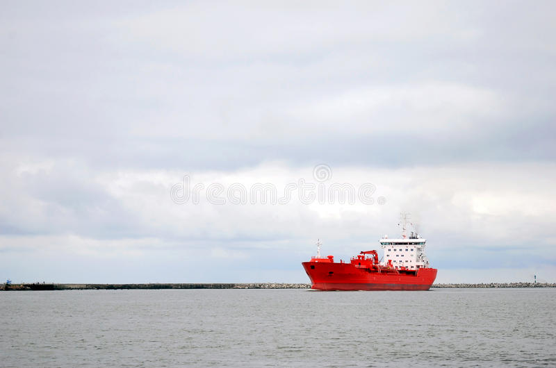 Red and white ship sailing in the sea royalty free stock photos