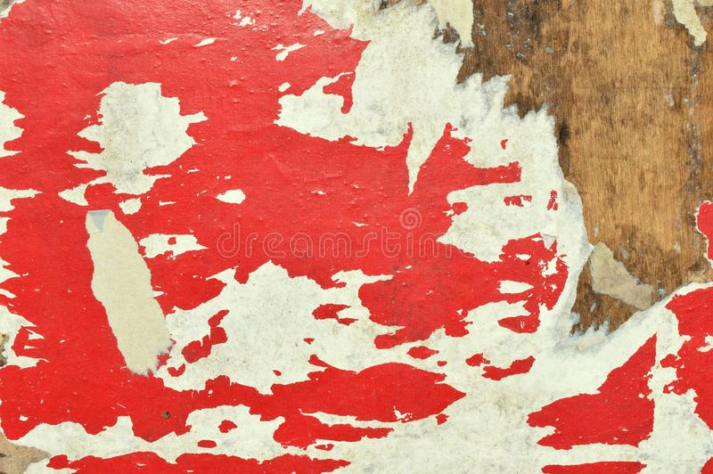 Red and white. The shreds of old posters on a billboard. Old advertising.Abstraction paper color royalty free stock photo