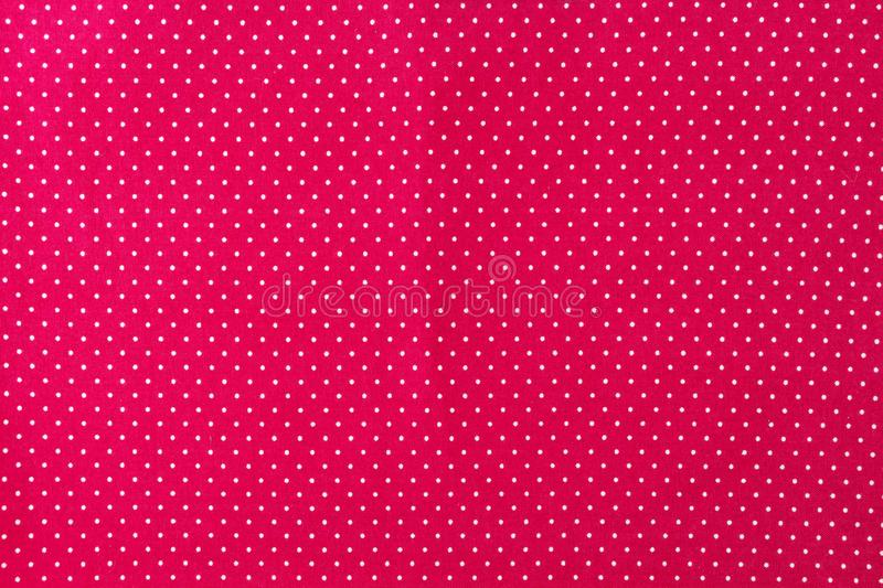 Red and white small polka dot classic fabric closeup, clean background royalty free stock image