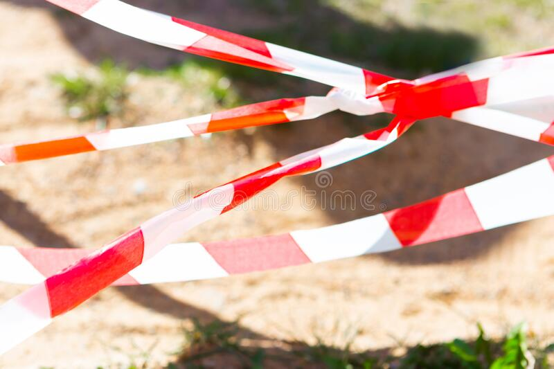 Red and white stripe barrier tape. Fencing red and white tape, warning tape stock image