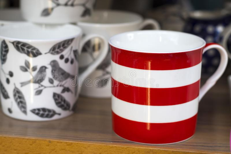 Red and white striped mug on a shop window. The Red and white striped mug on a shop window stock images