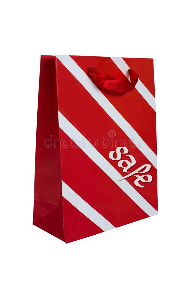 Red and white striped paper shopping bag. With the word Sale stock images