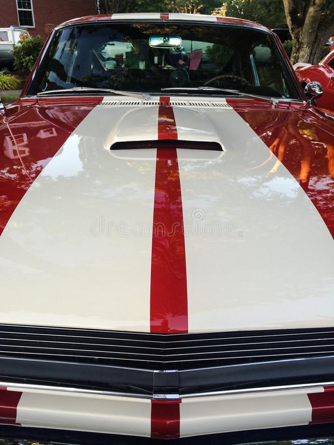 Red and white stripes on hood of classic race car royalty free stock photo