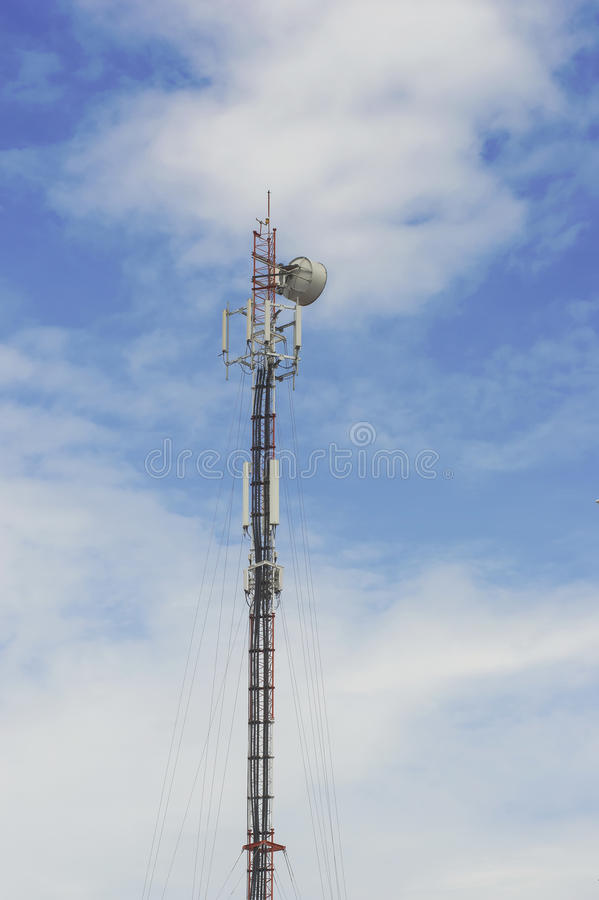 Red and White Telecommunication tower with blue sky and cloud. Red and White Telecommunication tower with sky and cloud background stock images