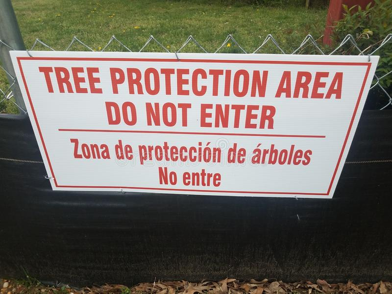 Red and white tree protection area do not enter sign. On fence stock photography