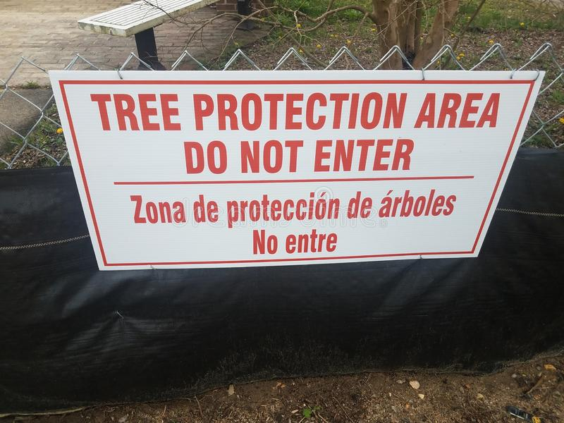 Red and white tree protection area do not enter sign. On fence royalty free stock photo
