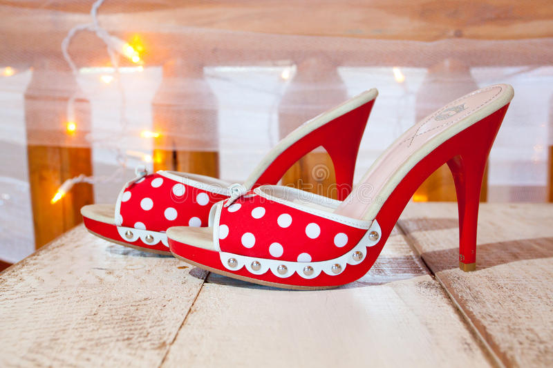 Red and White Wedding Shoes. A bride's wedding shoes in red and white with polkadots and heels stock images